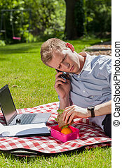 Man eating lunch in garden