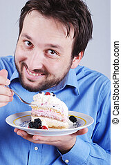 Man eating piece of chocolate cake