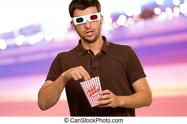 Man Eating Popcorn And Watching 3d Movie