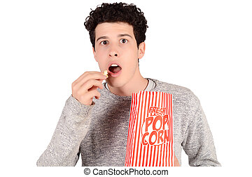 Man eating popcorn.