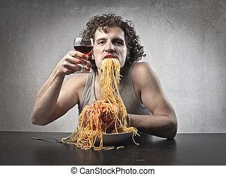 man eating spaghetti