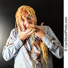 man eating spaghetti with tomato sauce in head - mad man...