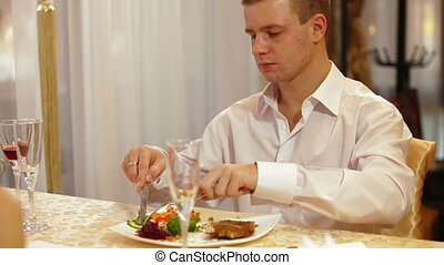 man eating steak at restaurant