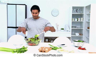 Man eating while he is cooking
