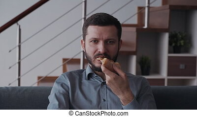 Man eating yummy pizza and relaxing at home - Handsome and...