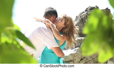 man embrace blonde girl