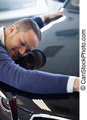 Man embracing a car
