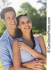 Man embracing woman from behind at