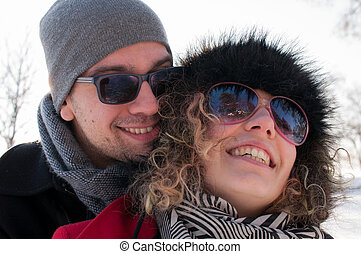 Man embracing young woman