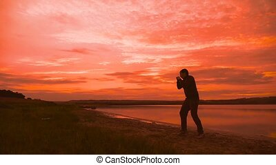 man engaged in melee combat sports sport boxing at sunset...