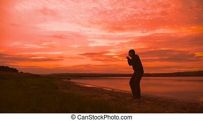 man engaged in melee sport combat sports boxing at sunset...