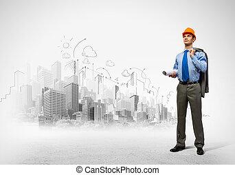 Man engineer - Image of man engineer in helmet with drafts. ...