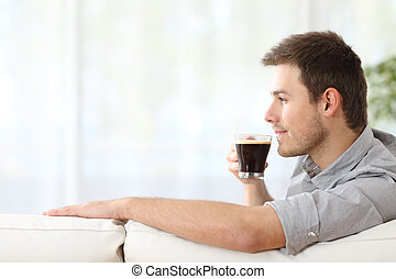 Man enjoying a cup of coffee at home