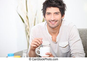 Man enjoying a cup of coffee