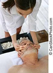 Man enjoying a face massage