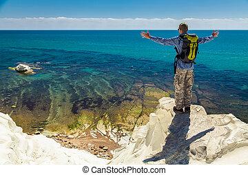 man enjoying amazing sea view