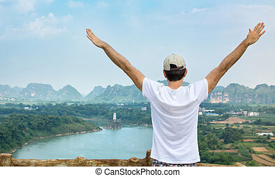 Man enjoying at the viewpoint. Outdoors lifestyle