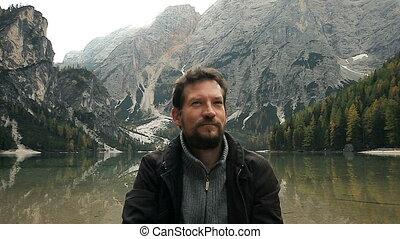 man enjoying beauty of nature