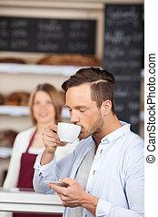 Man enjoying coffee in the bakery