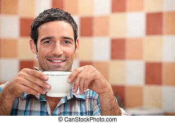 Man enjoying cup of coffee
