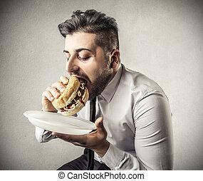 Man enjoying hamburger