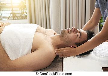 Man enjoying head and shoulders massage