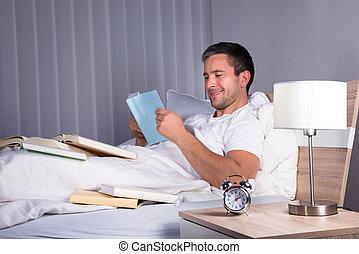Man Enjoying Reading Book