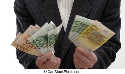 Man enjoying success and showing money in the direction of the camera - 4k