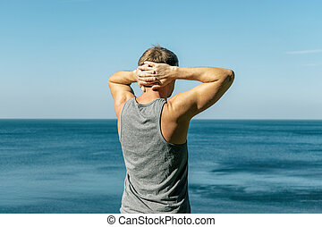 Man enjoying the view and fresh air on the ocean. Travel and a healthy lifestyle