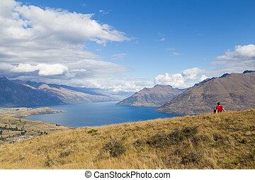 Man enjoying view from Queenstown Hill, New Zealand