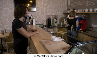 Man entering a coffee shop and ordering a cappuccino to go...
