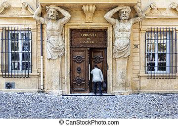 Man enters the commercial court in Aix en Provence