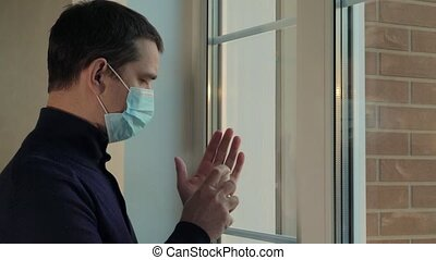 Man enters the house in a medical mask. Pandemic.