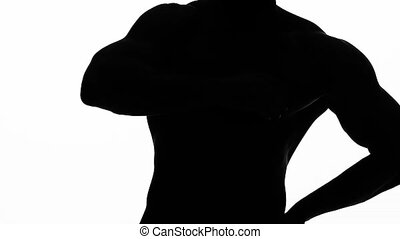 Man erotically dances . White background. Silhouette. Slow...