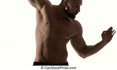 Man erotically dances . White background. Slow motion - Man...
