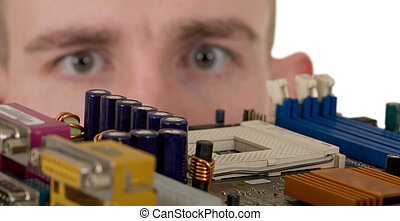 Man examines an electronic circuit
