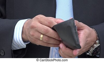 Man Examining His Wallet