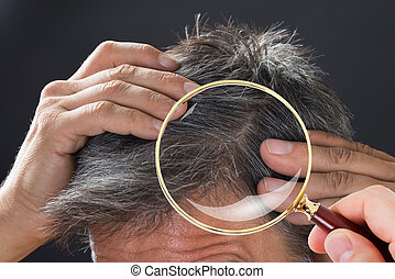Man Examining His White Hair