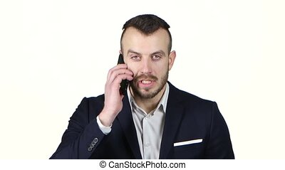Man exasperated talking on cell phone and screaming. White...