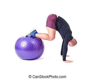 Man exercise with a pilates ball
