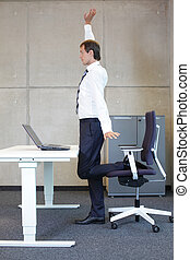 man exercises in office - exercises in office. business man...