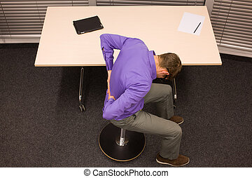 man exercising in office work