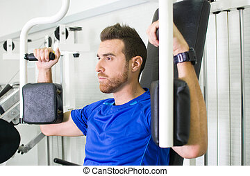 man exercising in the gym