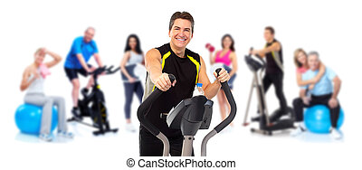 Man exercising on elliptical trainer.