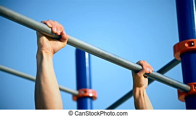 Man Exercising On Horizontal Bar