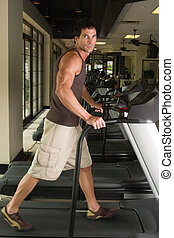 Man Exercising On Treadmill 3 - Man working out on a...