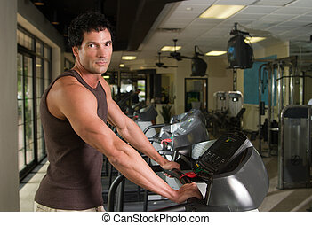Man Exercising On Treadmill 4 - Man working out on a...