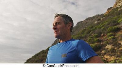 Man exercising outdoors taking a break