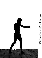 Man exercising Thai boxing in silhouette isolated