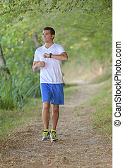man exercising wearing fitness watch